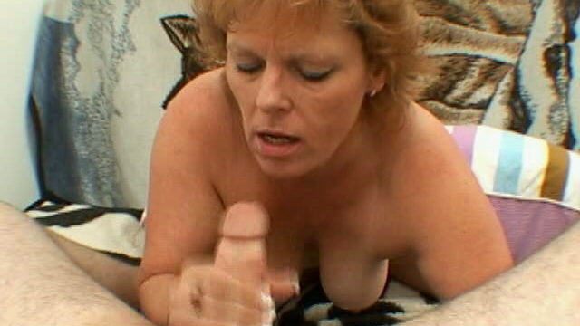Trashy Granny With Giant Tits Megan Provides Blowjob And Handjob On Her Knees